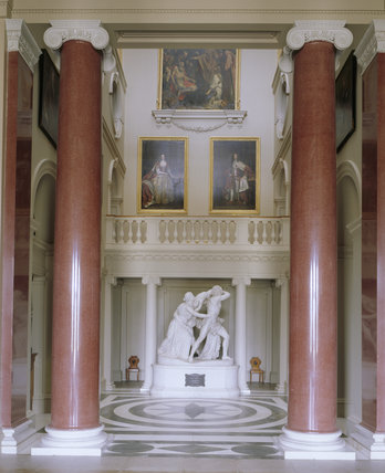 Room view of the Hall at Ickworth showing the Well of the Staircase, Flaxman's 'The Fury of Athamas', marble floor and the scagliola columns and pilasters