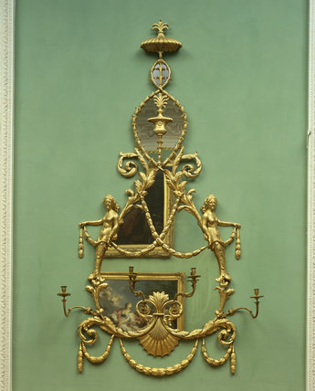 A close-up detail of the gilt girandole in the Entrance Gallery at Osterley Park