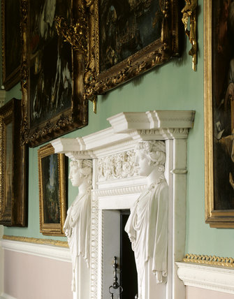 An angled view of the marble chimneypiece in the Long Gallery at Osterley Park