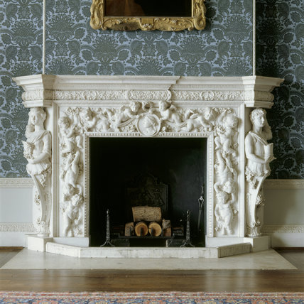 The corner figures on the saloon Chimneypiece at Claydon House illustrate the story of how the Corinthian order was invented, as described by Vitruvius, the ancient authority on classical architecture
