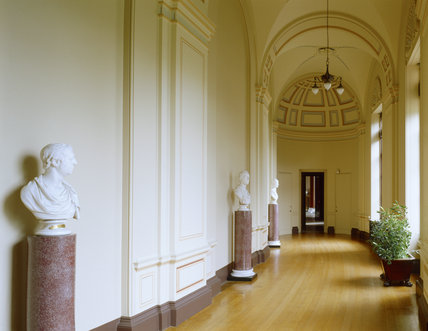 Room view of the West Corridor at Ickworth showing the busts on porphyry scagliola columns of the 1st Marquess of Bristol by Behnes, William Pitt by Nollekens and 2nd Earl of Liverpool