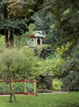 The Joss House set amongst the trees and plants many of which were brought back from the Far East to create the area of Biddulph Gardens designed to evoke China