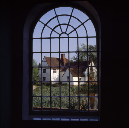 View of Willy Lott's House across the field, taken through a window in Flatford Mill