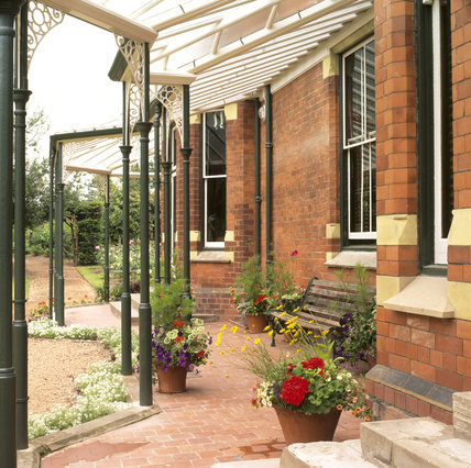 Beneath the verandah at Sunnycroft, with views of part of the ornamental gardens beyond