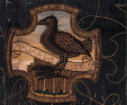 A bird on a motif of the Marian Needlework at Oxburgh Hall