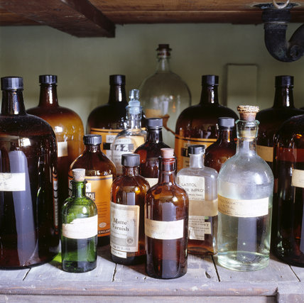 The Dark Room at 59 Rodney Street, Liverpool, the E. Chambre Hardman Studio, House and Photographic Collection - showing a close view of bottles of chemicals.
