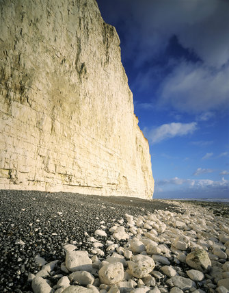 The dramatic white cliffs from the beach East of Birling Gap, Seven Sisters, clearly showing the shear angle and debris of fallen rocks on the beach below