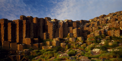 The Giant's Causeway, renowned for its polygonal columns of layered basalt, is the only World Heritage Site in Ireland & results from a volcanic eruption 60 million years ago