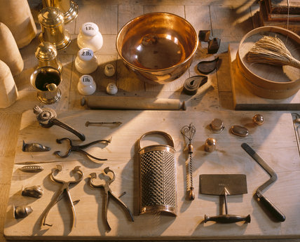 Saltram, the kitchen, detailed view of a collection of kitchen utensils and weights