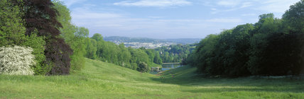 View over Prior Park towards the Palladian Bridge, with Bath in the background