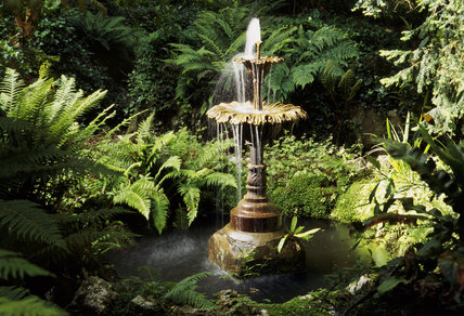 Close-up view of the Victorian fountain and fernery in the garden at Greenway