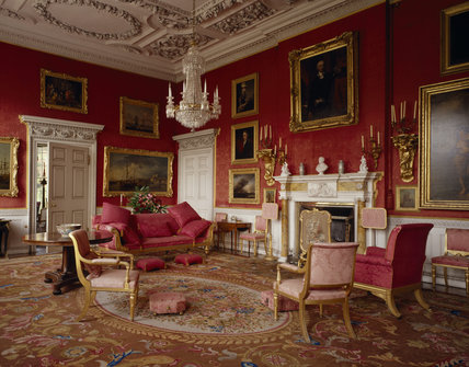 A corner of the Drawing Room, with armchairs and a settee, grouped round the ornate fireplace