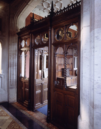 The panelled wooden screen (1851) by Barry in the entrance hall at Gawthorpe Hall