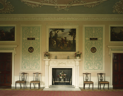 The Eating Room at Osterley Park, facing the fireplace, with magnificent plasterwork panels, decorated in pale blue, pale pink and white