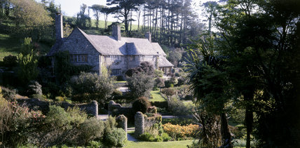 A view, across the garden, of the House at Coleton Fishacre