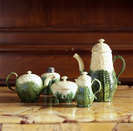 Various items of green and white ceramics in the Dining Room of the Treasurer's House, York