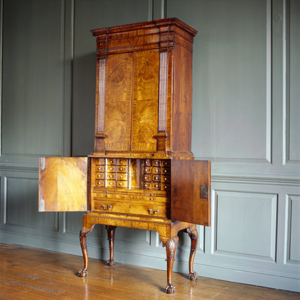 The Queen Anne walnut secretaire-bureau in the Court Room, at the Treasurer's House, York
