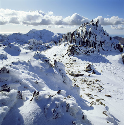 View of the snow topped summit of Glyder Fawr