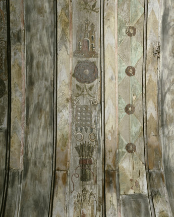 The painted roof in the Tudor Chapel at Ightham Mote showing symbols of Henry VIII and Catherine of Aragon