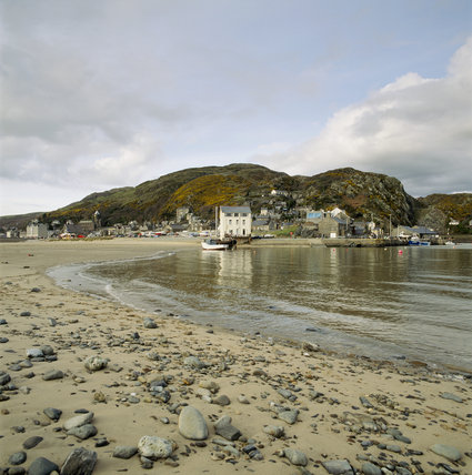 Dinas Oleu, the gorse covered stretch of the fell, seen from Barmouth beach