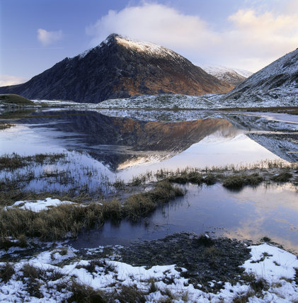 Pen yr Ole Wen reflected in the still waters of Llyn Idwal (looking north) at dawn