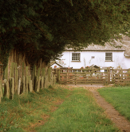 Partial view of High Yewdale Farm and tombstone hedging, Coniston, Cumbria