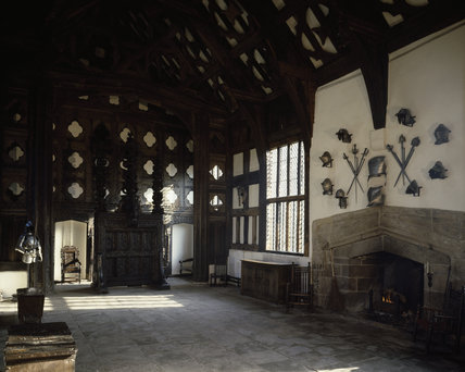 Rufford Old Hall, The Great Hall with stone flagged floor, timbered walls and armour above fireplace