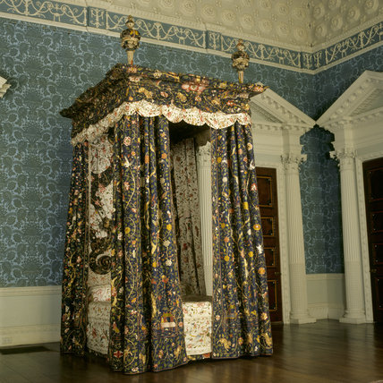 The State Bed, with colourful Chinese silk hangings, which probably came to Calke Abbey in 1734 with the marriage of Lady Caroline Manners and Sir Henry Harpur, 5th Baronet