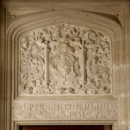 Carved stonework by Barry dated 1851 above the entrance door to the library at Gawthorpe Hall