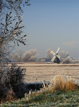 The restored windpump in Wicken Fen in the midst of a hoar frosted landscape