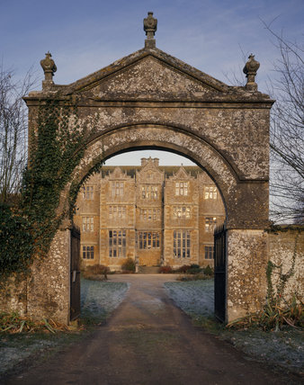 View of the south front of Chastleton seen through the entrance gates
