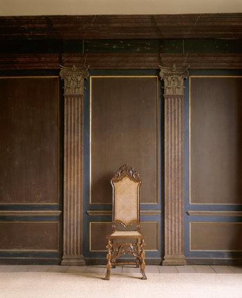 An early C18th tall backed walnut chair with caned seat and back,  in the Painted Parlour at Canons Ashby
