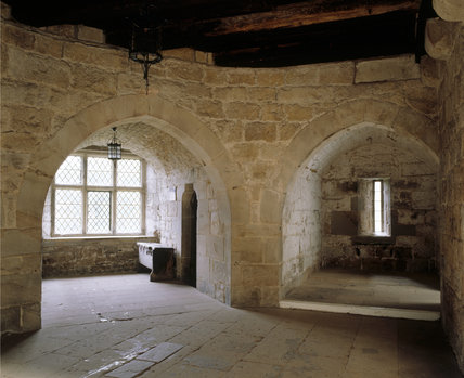 View of two arched chambers in Adam's Tower at Chirk Castle showing a square mullioned window of c 1600