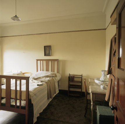 The Servant's Bedroom at Sunnycroft, showing the wooden bedstead, wash stand and washing jug and basin