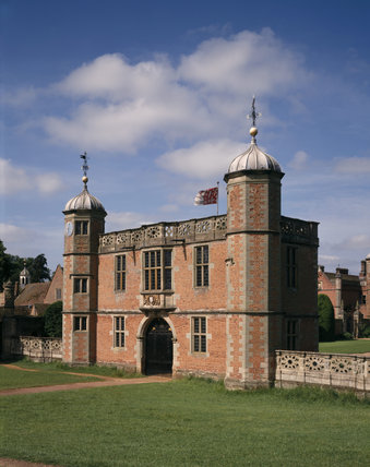 Oblique view of the Gatehouse with twin octagonal towers surmounted with ogival-shaped lead cupolas