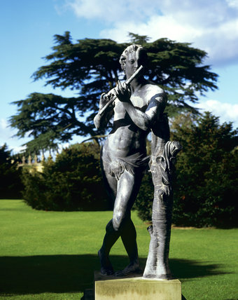 The statue of a near naked man, in the grounds of Hardwick Hall, he is leaning on a tree trunk and appears to be playing a flute