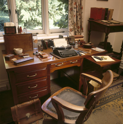 Close-up view of George Bernard Shaw's large desk in the Study at Shaw's Corner, remaining exactly as he left it with typewriter, pens, pocket dictionaries and correspondence