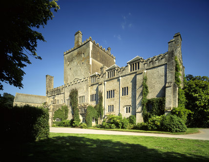An oblique view of the north front of Buckland Abbey, with the Tower rising up in the middle