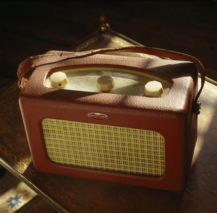 Close-up of a little red radio on a table in the Drawing Room