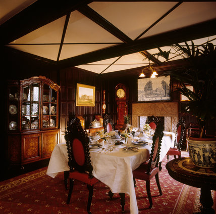 View of the Small Drawing Room showing the table set for a meal
