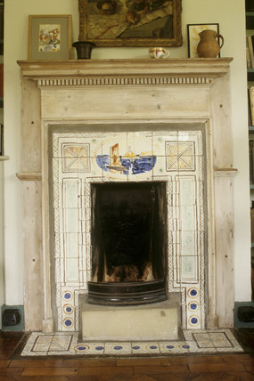 Fireplace with painted tiles by Vanessa Bell at Monk's House, in Virginia Woolf's bedroom