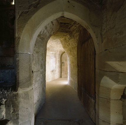 View through the arched doorway along the corridor in Adam's Tower at Chirk Castle
