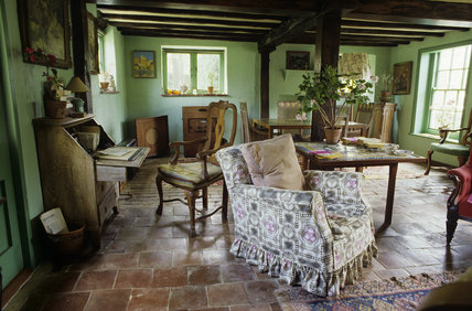 Sitting Room at Monk's House with green walls painted by Virginia Woolf, quarry tiled floor, sun streaming through windows