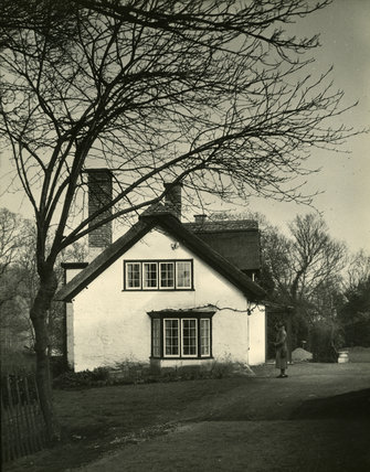 Thatched Cottage with Woman