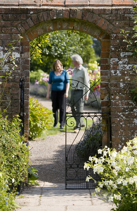 Visitors in the garden at Baddesley Clinton, Warwickshire.
