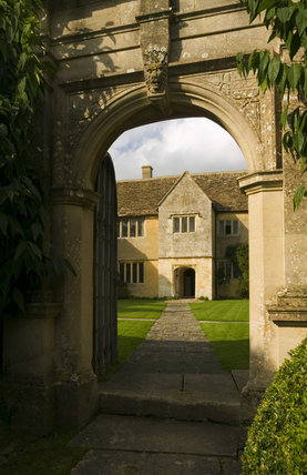 View through the stone gateway entrance arch of the late fifteenth-century house, Westwood Manor, altered in 1610, but retaining the late Gothic and Jacobean windows, near Bradford-on-Avon, Wiltshire