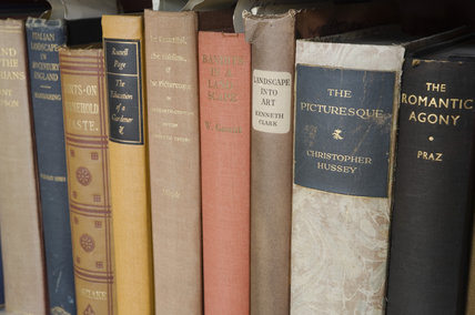 Spines of books in the white-painted bookshelves in the Study in the new house at Scotney