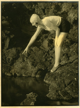 Margaret Hardman pointing into a Rock Pool