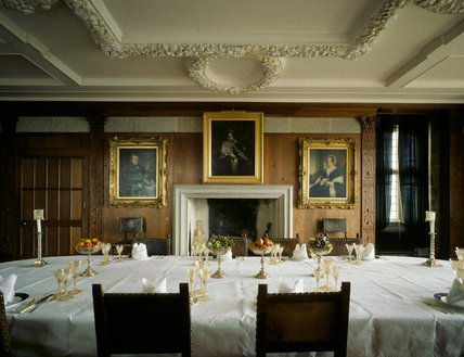 Castle Drogo, The Dining Room, with the table laid with china and glass, napkins and dishes of fruit