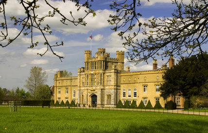 The West Front of Coughton Court, Warwickshire with the sixteenth-century Gate Tower in the centre and two wings on either side added in the eighteenth century